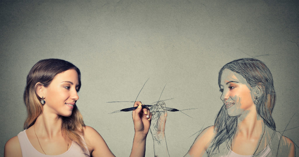 photo illustration of girl drawing herself