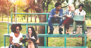 Teenagers sitting on bleachers