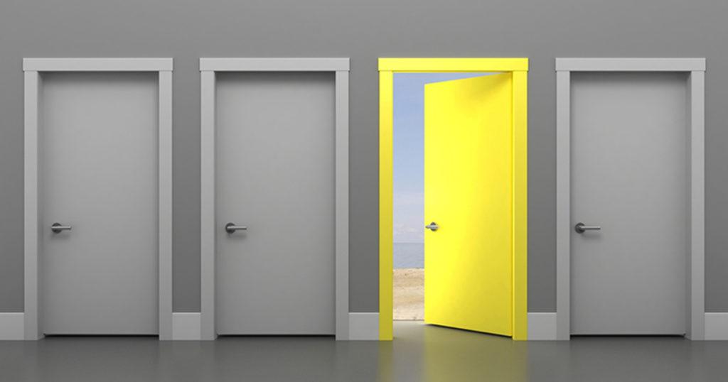 three gray doors and one open yellow door
