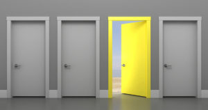 three gray doors and one open yellow door