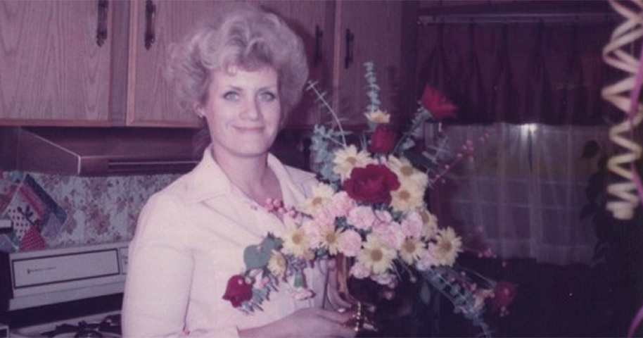 woman with bouquet in kitchen