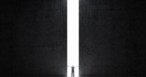 person standing between giant doors