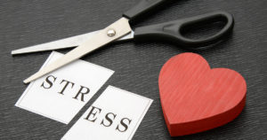 scissors heart and cut paper reading stress